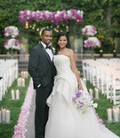 African American bride in strapless Vera Wang wedding dress with groom in tuxedo at Four Seasons