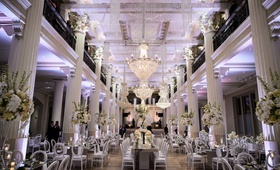 wedding reception at the corinthian in houston white columns purple lighting white flowers modern