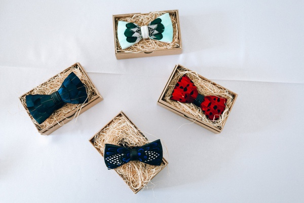 four bow ties, green velvet bow tie, read and black bow tie, feather bow tie, two-tone mint bow tie