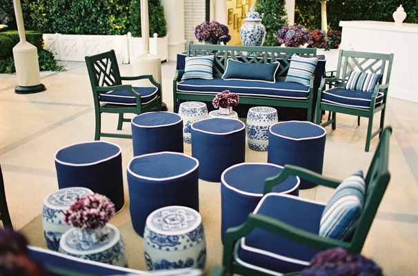 Blue and white ottomans and couch cushions