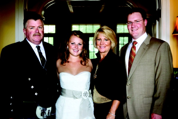 Bride in a Vera Wang gown with family