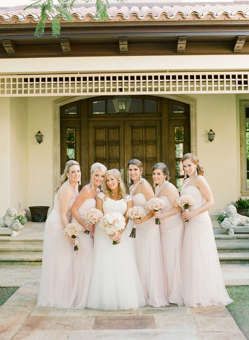 Bride in a Monique Lhuillier gown with bridesmaids