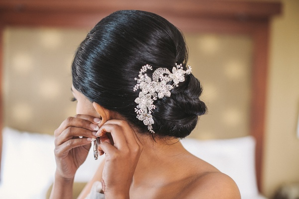 Bride wearing knotted bun with glitzy headpiece