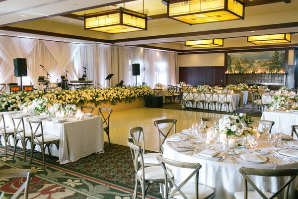 wedding reception ballroom the lodge at torrey pines wood chairs white flowers greenery dance floor