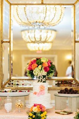 bridal shower cake white ruffles pink orange sugar flowers bride to be gold cake topper desserts