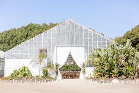 Dos Pueblos Orchid Farm in santa barbara area venue greenhouse white drapery landscaping desert chic