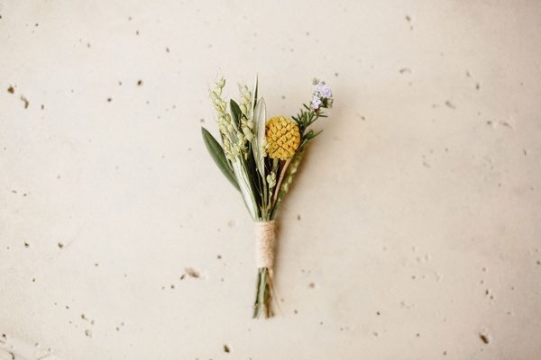 wedding boutonniere wrapped with twine yellow lavender greenery leaves