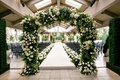 Wedding ceremony tented deck country club venue green white natural motif theme design