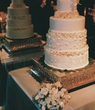 Four layer wedding cake with rose flowers