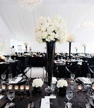 Black sequin tablecloth with tall black centerpiece and white flowers