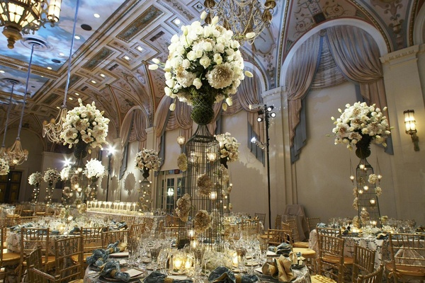 Handpainted ceiling in ballroom with large flower centerpieces
