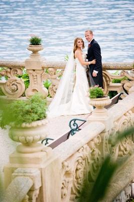 Wedding couple on lakefront terrace in Lake Como, Italy