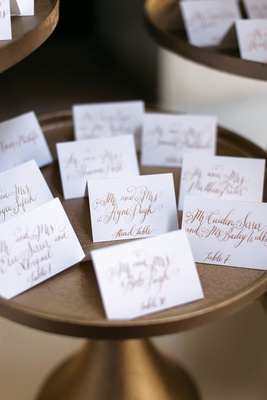 escort card with fancy script gold calligraphy