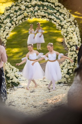 outdoor wedding ceremony inspired by heaven angels ballerinas ballet dancers on flower petal aisle