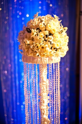 Blue lighting and crystal strands on flower stand
