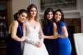 Bride with sleeves detachable arm sleeves with bridesmaids mismatched royal blue gowns and mother
