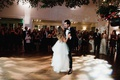 bride in layered tulle wedding dress stanley korshak groom first dance pretty lighting