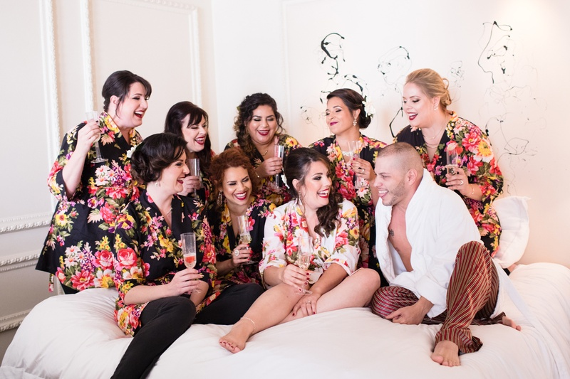 bridesmaids in black floral bridesmaid robes's bridesman