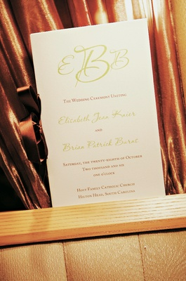 Ceremony booklets fastened with brown ribbon