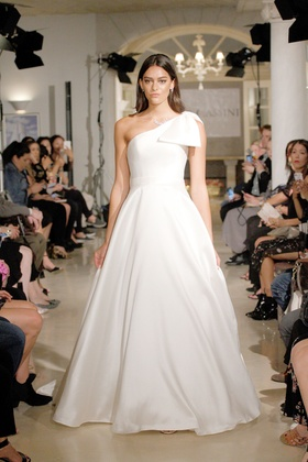 Oleg Cassini Fall 2018 bridal collection mikado ball gown with one shoulder neckline and bow
