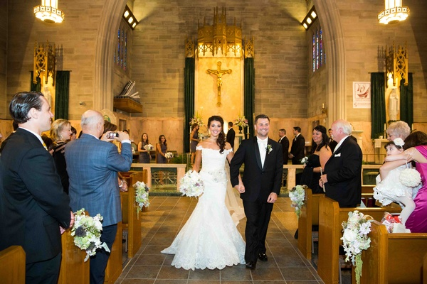 Bride and groom exit ceremony at Roman Catholic church