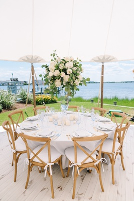 backyard tented wedding reception, vineyard chairs, centerpiece with roses and eucalyptus leaves