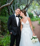bride in spaghetti strap monique lhuillier wedding dress lace flower design groom in tuxedo bow tie