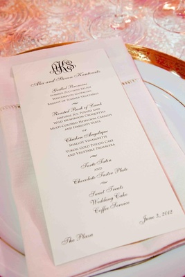 Wedding reception menu with bride and groom's monogram