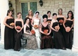 Bridesmaids in chocolate brown strapless dresses