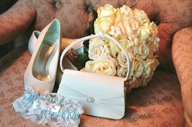 Wedding shoes and bridal bag with garter and bouquet