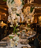 Wedding reception white lacquer table winding gold black place settings white centerpieces