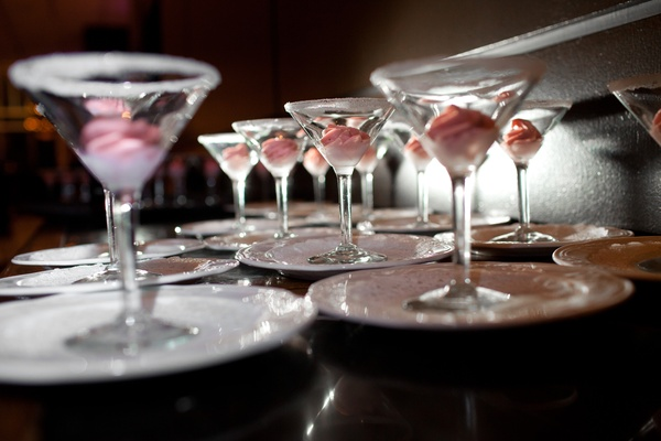 Martini glasses with sugar rims filled with pink ice cream