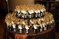Wedding favor display table with bottles of Champagne