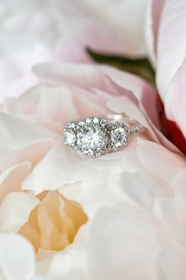 Three stone diamond engagement ring with three halo settings and diamond band