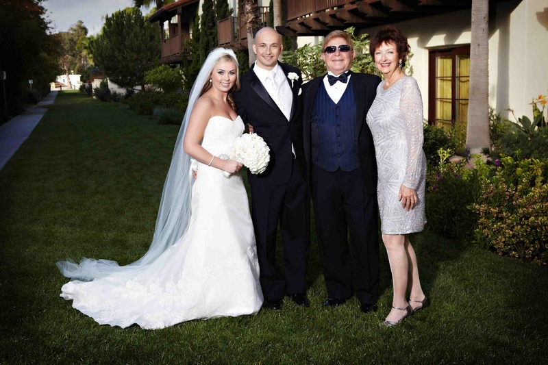 Wayne Foster Entertainment founders with bride and groom