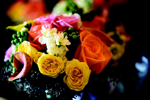 Bouquet of yellow, orange, pink, and white flowers