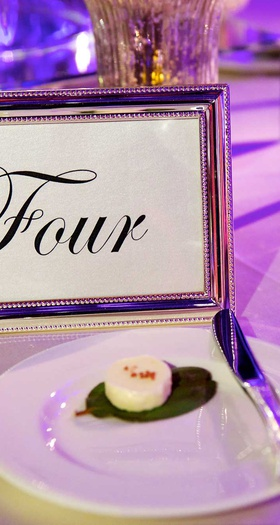 Table number in silver metallic frame with script font number written out