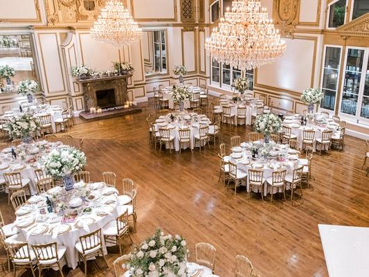 wedding reception ballroom chandelier fireplace los angeles downtown blue white vase gold details