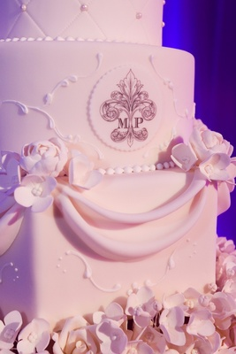Wedding cake with sugar monogram and flowers