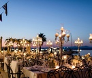 courtyard reception on greek coast, candelabra lantern