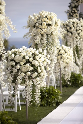 White roses and hydrangeas on iron stands