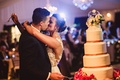 Wedding reception bride and groom cake cutting kiss cake topper of bride parents