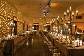 Ample candelabras and custom lighting create an enchanting winter wedding reception.