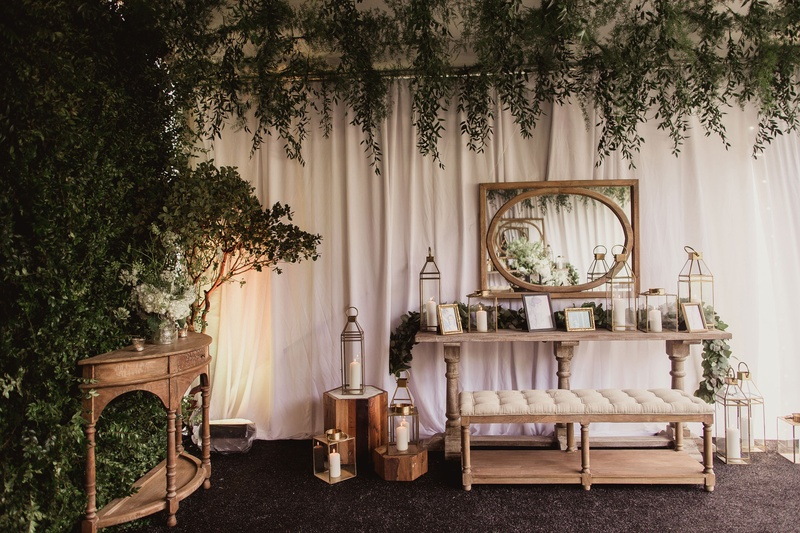 reception lounge area with photos and lanterns