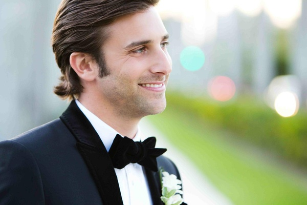 Handsome groom with velvet lapel and bow tie