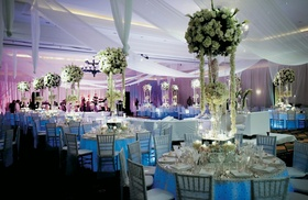 White drapes and tall centerpiece designs