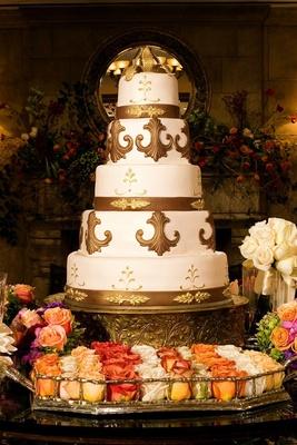 Gold fleur de lis wedding cake with gold cake topper