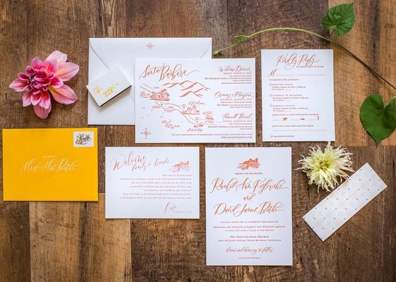 wedding invitation with map of santa barbara rsvp card details orange calligraphy yellow envelope