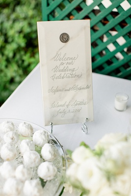 small wedding welcome sign in marble with wax seal and silver calligraphy
