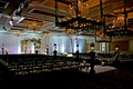 Rustic wedding ceremony chairs and light fixtures